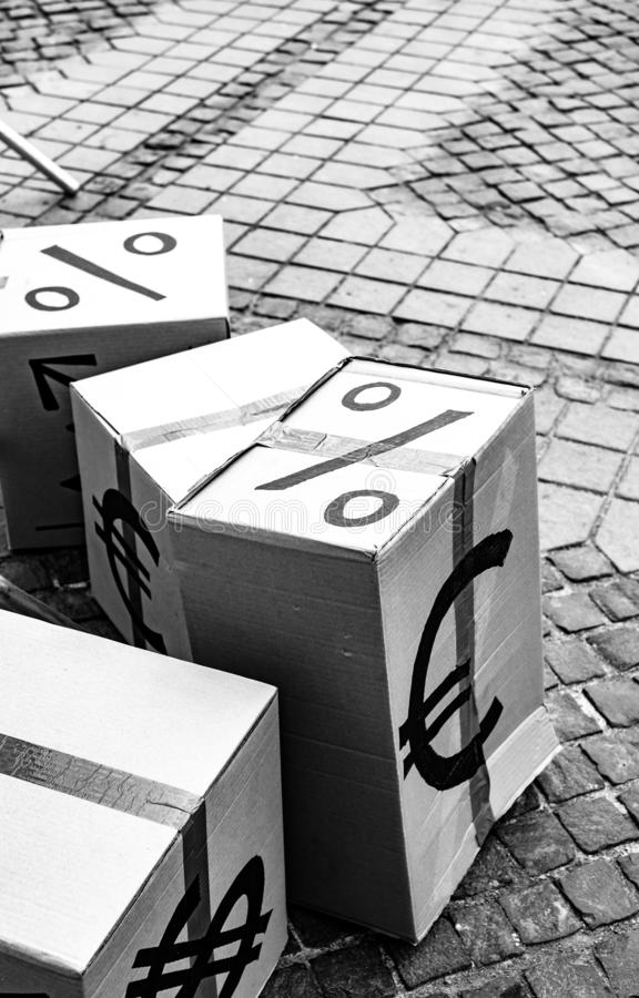 Cartoon boxes with euro and dollar signs. In Sibiu center, Romania stock images