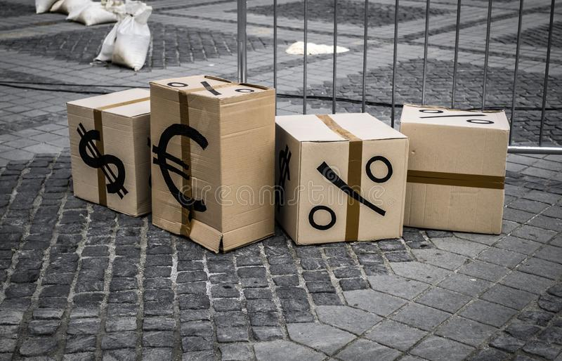 Cartoon boxes with euro and dollar signs. In Sibiu center, Romania stock photo