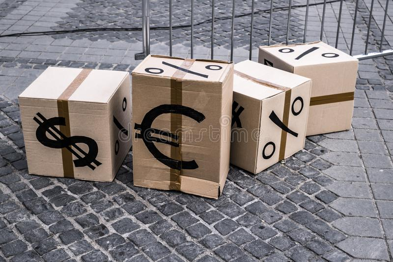 Cartoon boxes with euro and dollar signs. In Sibiu center, Romania royalty free stock photos