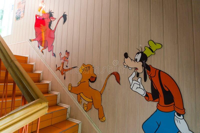 Cartoon characters. Walt Disney cartoon characters decorating house wall stock images