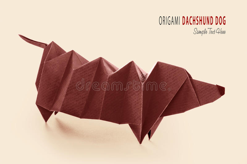 Cartoon origami dachshund dog. Cartoon art isolared origami of cute brown purebred dachshund dog on beige stock photo