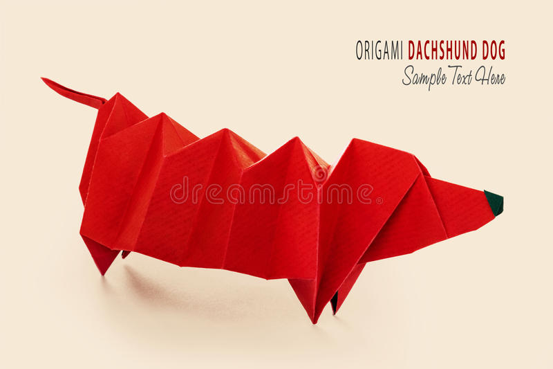 Cartoon origami dachshund dog. Cartoon art isolared origami of cute red purebred dachshund dog on beige stock photography