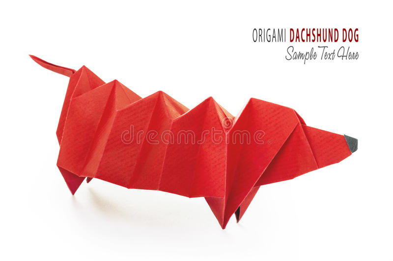 Cartoon origami dachshund dog. Cartoon art isolared origami of cute red purebred dachshund dog on white stock images