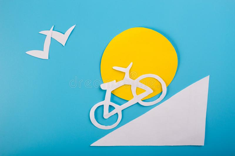 Cartoon styled image with bike. In the moutains royalty free stock photo
