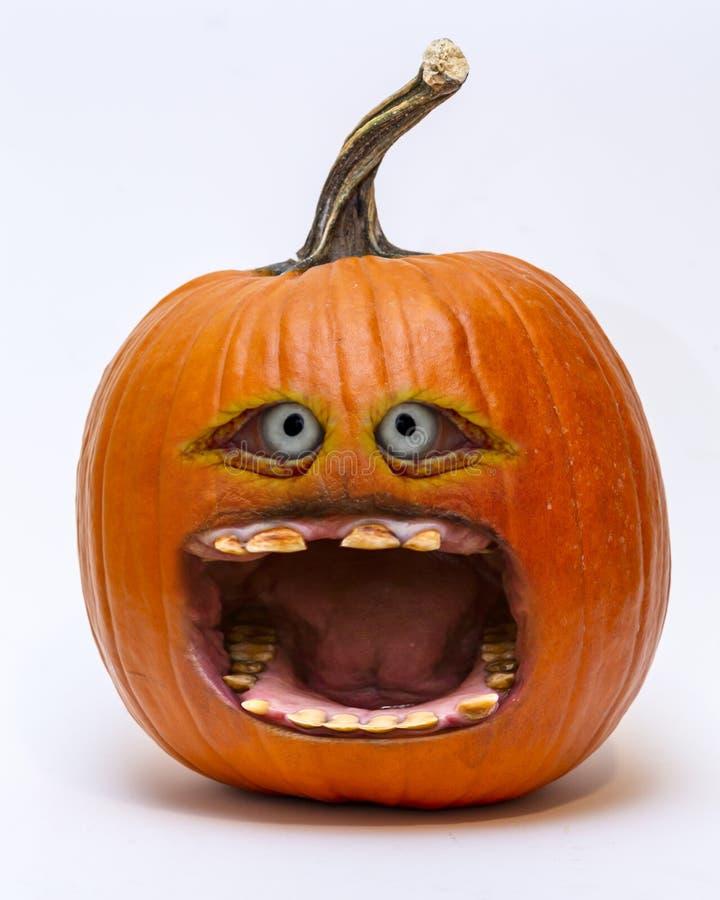 Comic screaming halloween jack-o`-lantern pumpkin isolated on white royalty free stock image