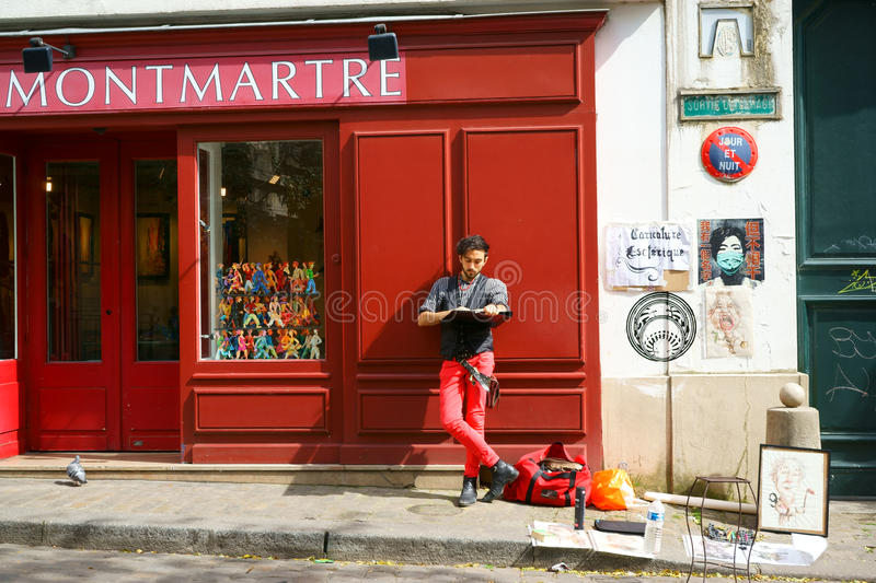 Cartoonist in Montmartre. Man drawing humorous portraits in Montmartre, Paris, France. April 10, 2015 royalty free stock photo