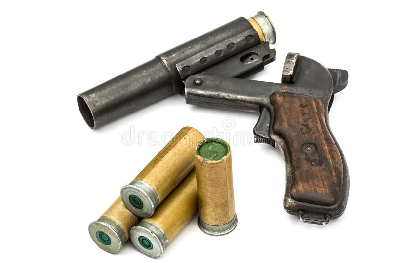 Cartridge is inserted into the barrel flare gun, isolated. On white background royalty free stock photo