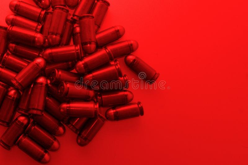 Cartridges bulk close up images. Bullets in shells for gun are piled randomly. Weapon armory concept royalty free stock images