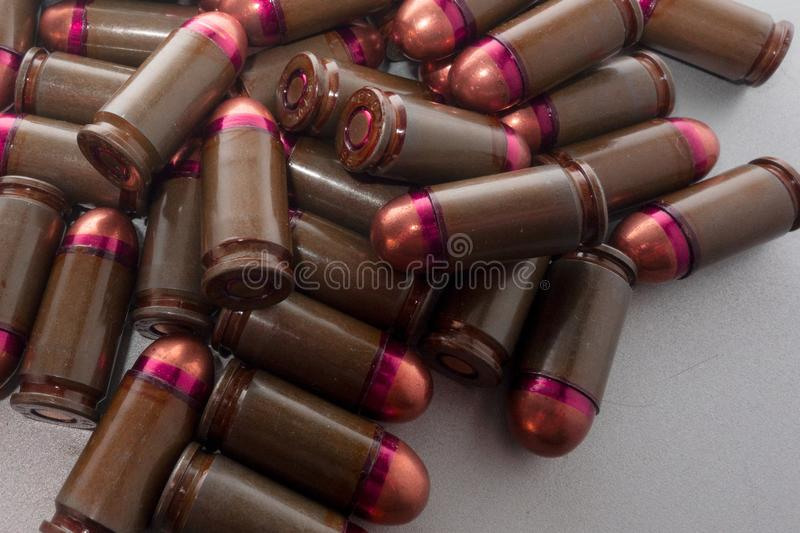 Cartridges bulk close up images. Bullets in shells for gun are piled randomly. Weapon armory concept royalty free stock photo