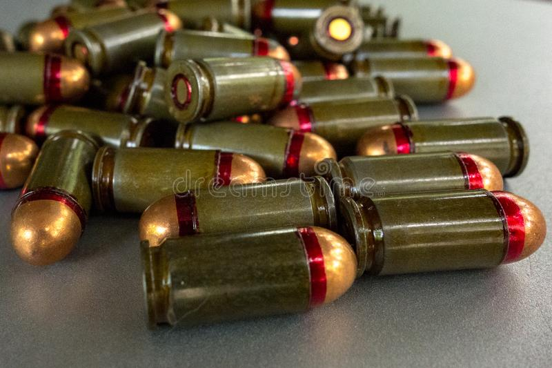 Cartridges bulk close up images. Bullets in shells for gun are piled randomly. Weapon armory concept royalty free stock image
