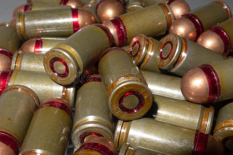 Cartridges bulk close up images. Bullets in shells for gun are piled randomly. Weapon armory concept stock photo