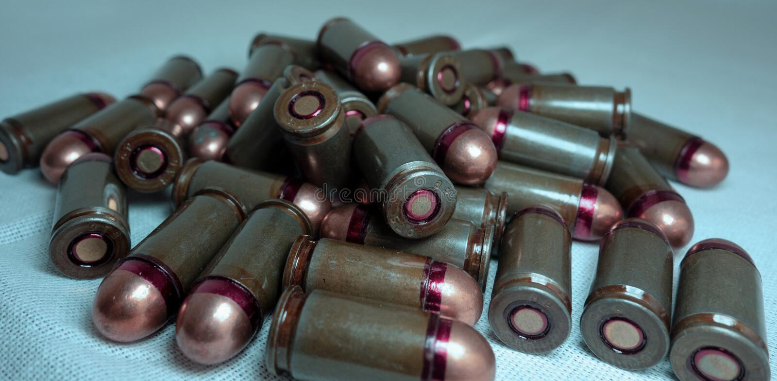 Cartridges bulk close up images. Bullets in shells for gun are piled randomly. Weapon armory concept royalty free stock photos