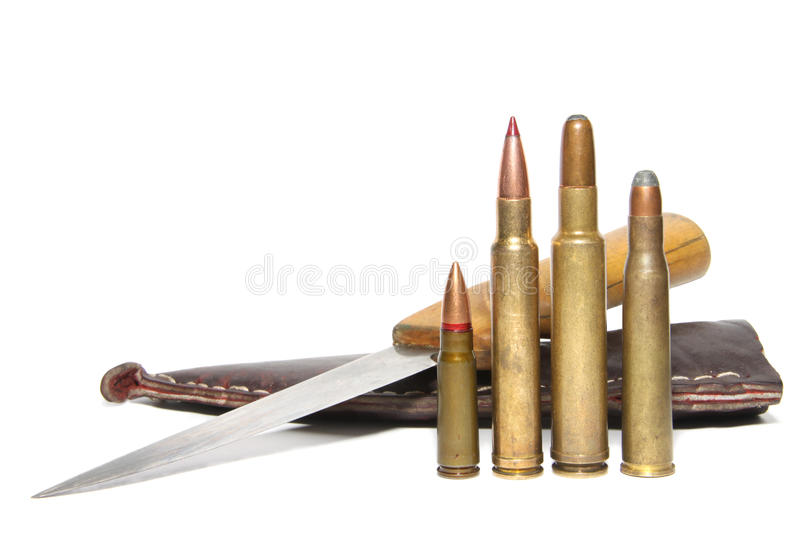 Cartridges and hunting knife. 4 different caliber rifle cartridges and hunting knife isolated on white stock photos
