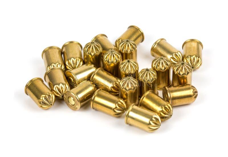 Cartucce del gas ed in bianco per le pistole immagini stock libere da diritti