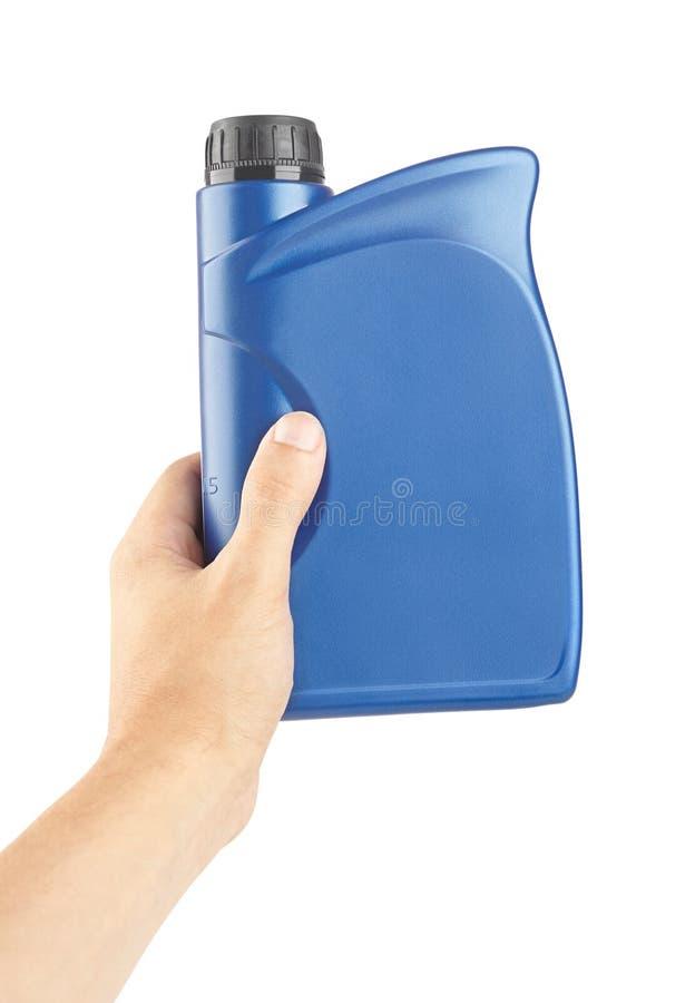 cartucho plástico azul para lubrificantes à disposição, recipiente para a química isolado fotos de stock royalty free