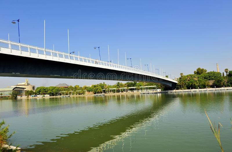 Cartuja bridge over the Guadalquivir River, Seville, Andalusia, Spain. One of the bridges that connect the two banks of the Guadalquivir river as it passes stock images