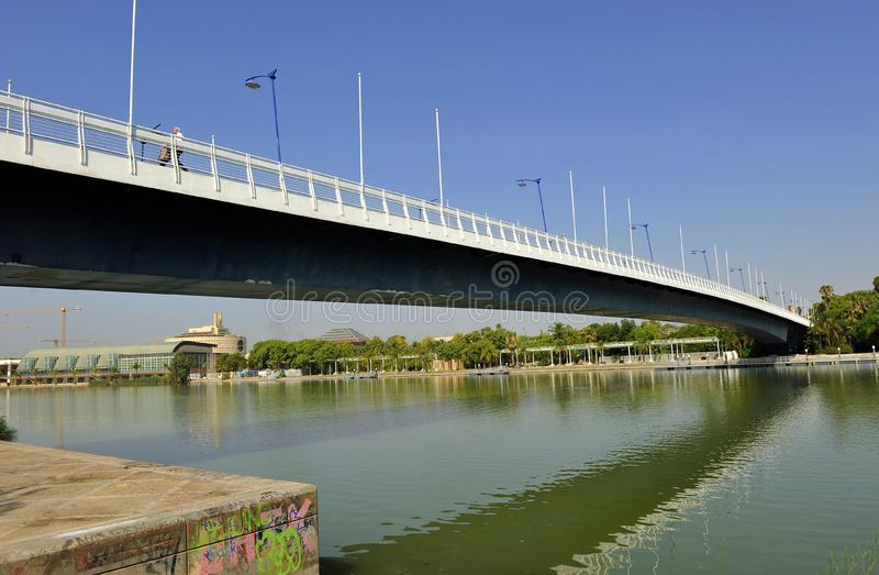 Cartuja bridge over the Guadalquivir River, Seville, Andalusia, Spain. One of the bridges that connect the two banks of the Guadalquivir river as it passes royalty free stock photos