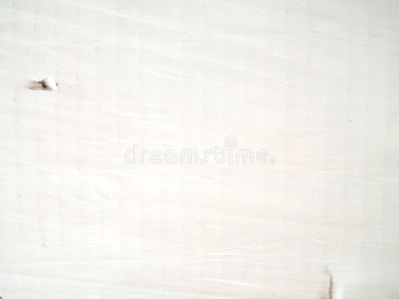 Cartulina blanca cubierta con el envoltorio de plástico fotografía de archivo libre de regalías