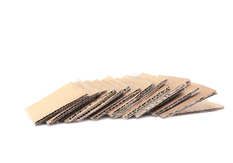 Cartulina de Brown en el fondo blanco imágenes de archivo libres de regalías