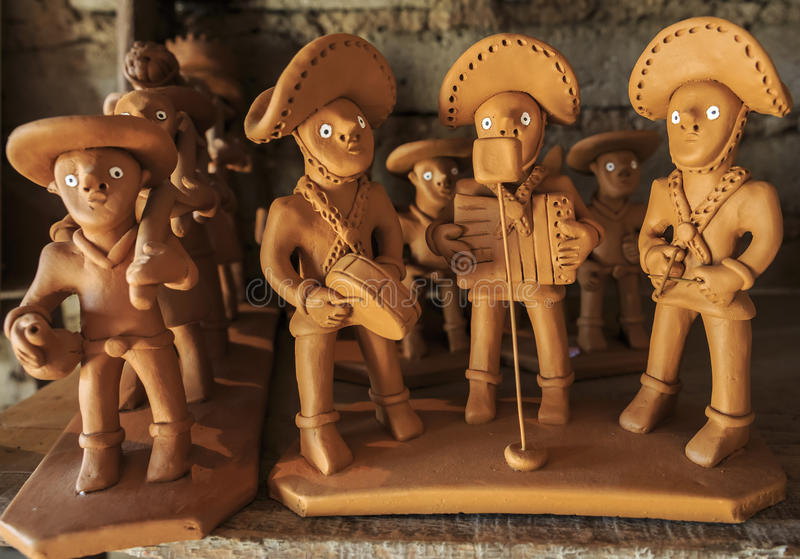 Caruaru. Little clay sculptures representing the notorious Brazilians Virgulino Ferreira and Maria Bonita dressed in cangaco clothes and bearing guns royalty free stock photo