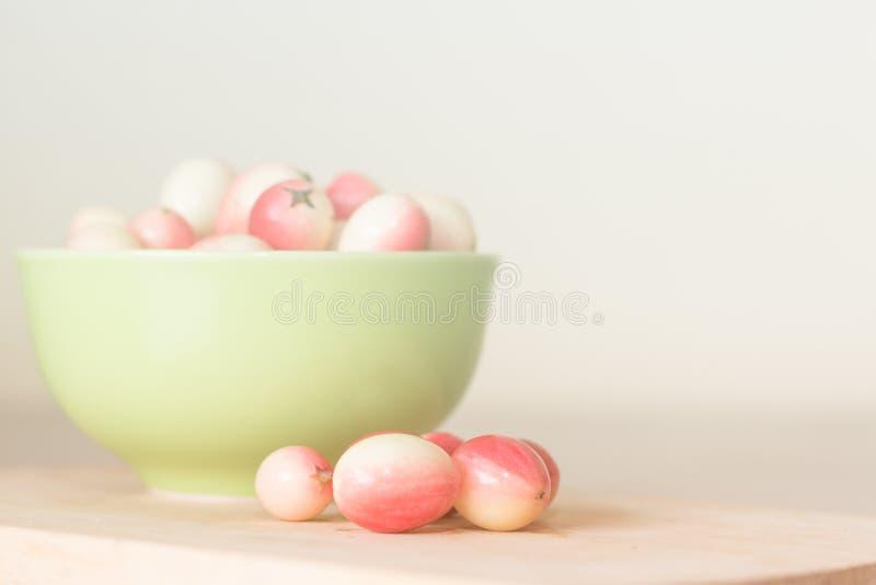 Carunda ( Karonda ) in green bowl royalty free stock photography