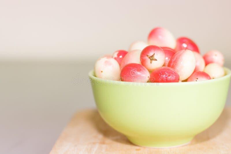 Carunda ( Karonda ) in green bowl stock images