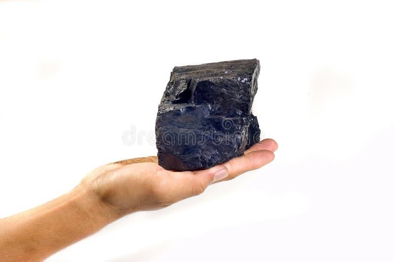 Carvão na mão fotografia de stock royalty free