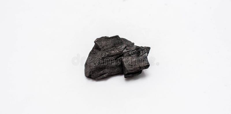 Carvão vegetal no fundo branco fotografia de stock