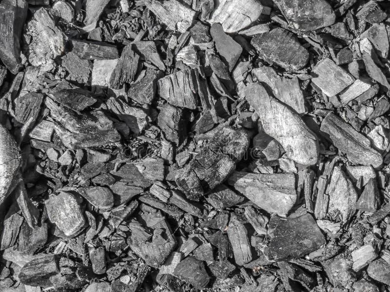 Carvão vegetal preto dispersado, imagem de fundo imagem de stock