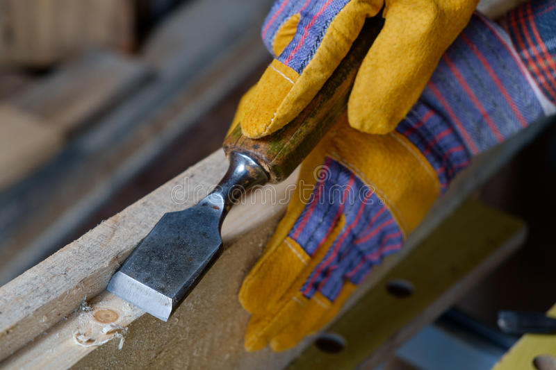 Carve with a chisel. Close-up of a joinery hands carve with a chisel stock photos