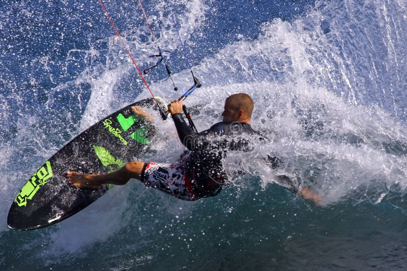 Carve on wave. Kitesurfing turning on wave royalty free stock images
