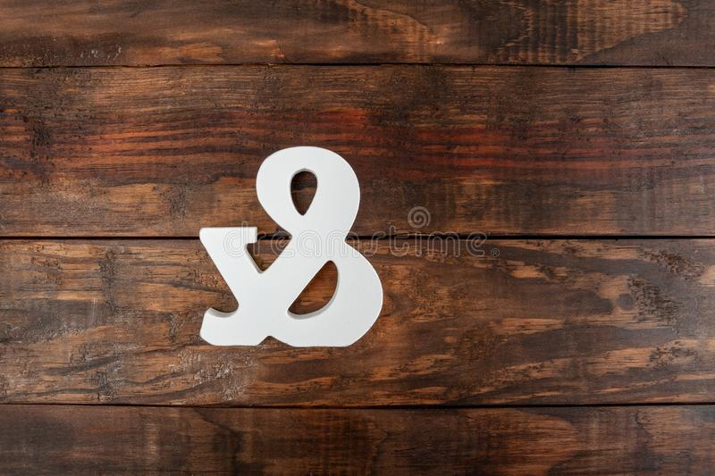 Carved ampersand symbol on wooden table. royalty free illustration