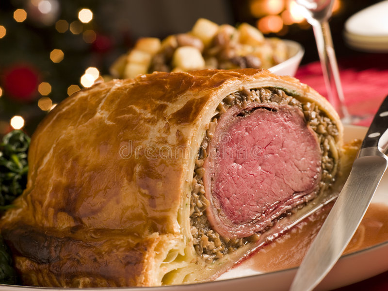 Carved Beef Wellington. On a table royalty free stock image