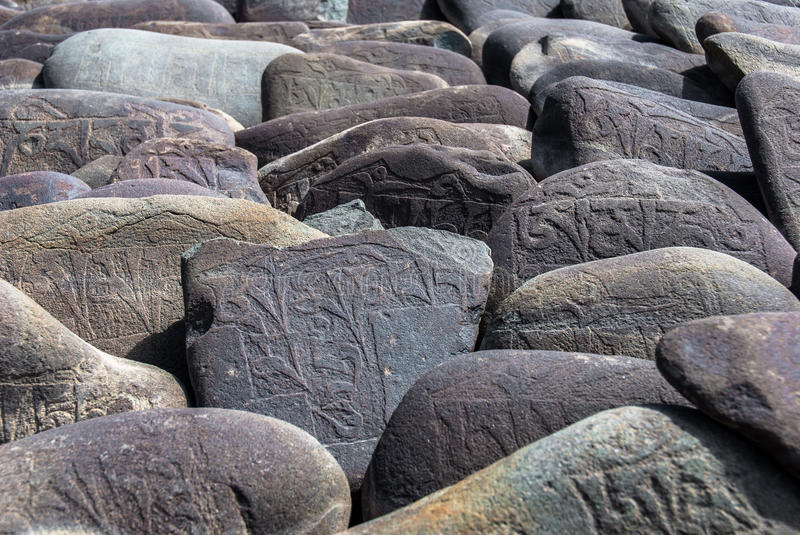 Carved Buddhist Mani Stones royalty free stock image
