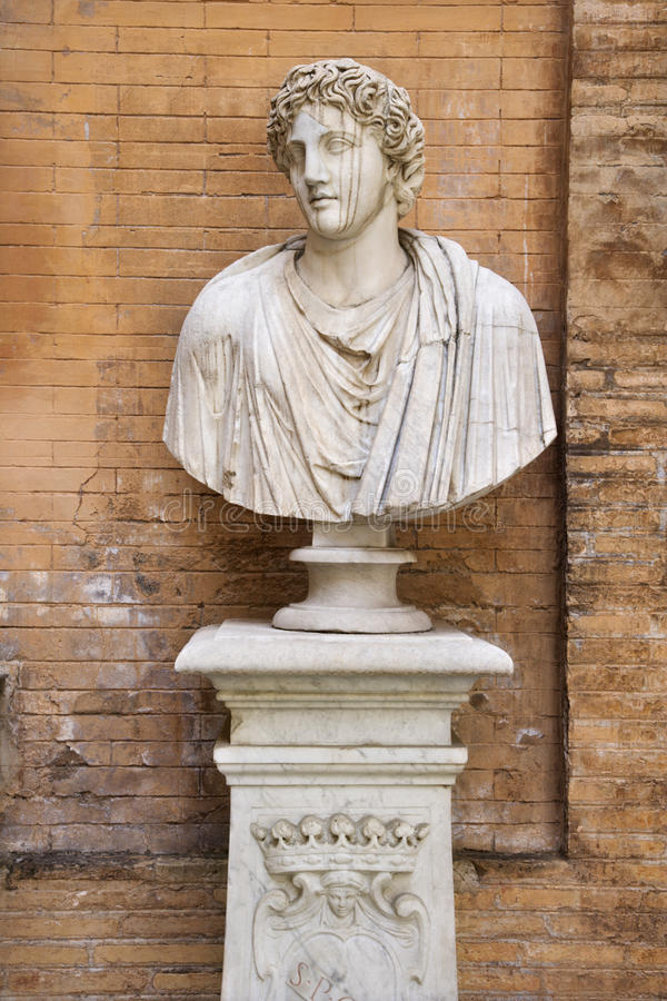Download Carved Bust In Front Of Brick Wall Royalty Free Stock Image - Image: 12978186
