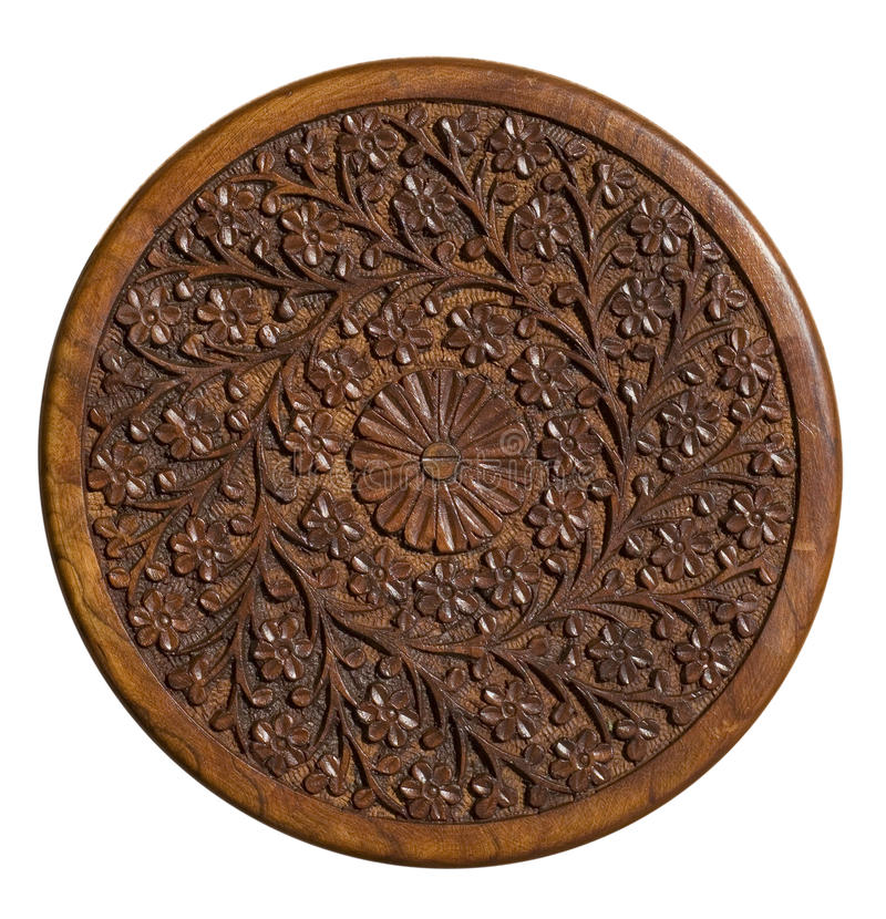 Carved circular wood panel with floral design royalty free stock images