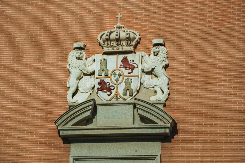 Carved decoration with coat of arms from Spanish royalty in Madrid royalty free stock photo