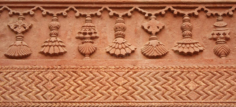 Carved decorative pattern on stone
