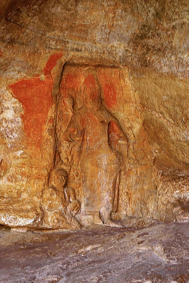 Carved figure in an unfinished cave, Badami Caves, Karnataka stock image
