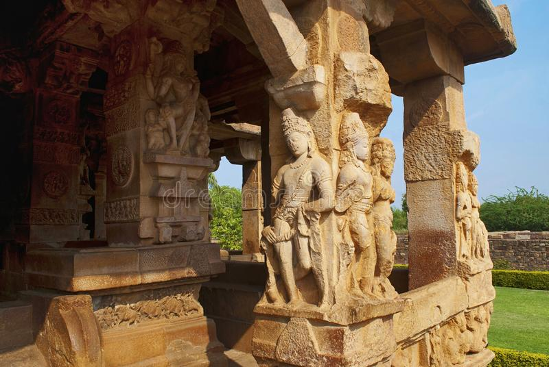 Carved figures of the god on the decorated sober and square pillars of the entrance porch of Durga temple, Aihole, Bagalkot, Karna. Taka, India. The Galaganatha stock image