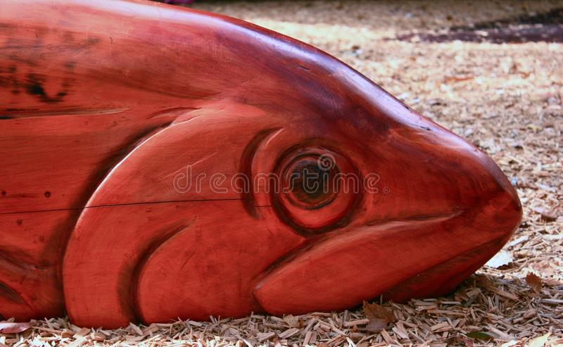 Carved Fish. Carved carving art artistic naive wood wooden humor humorous fish eye deceptive street art sculpture fun funny humor hunor royalty free stock image