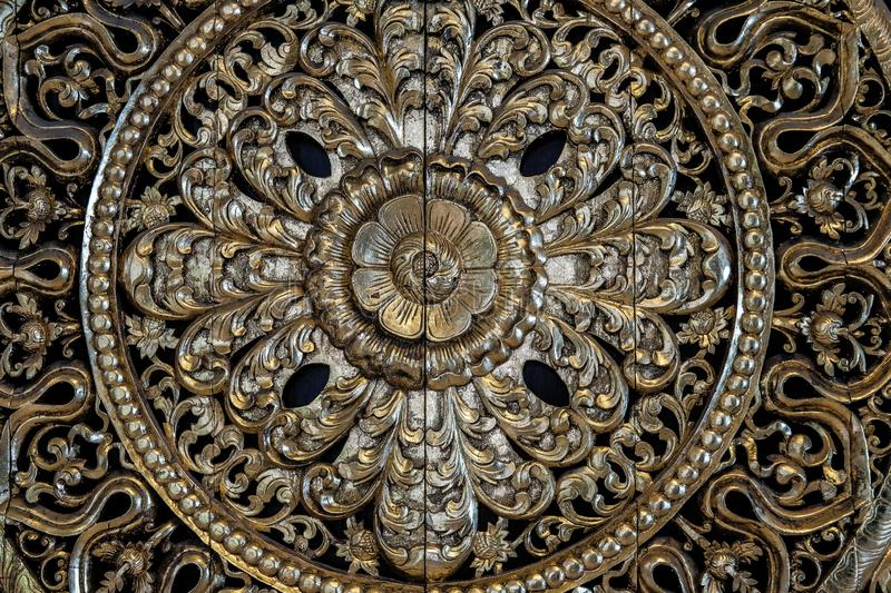 Carved golden flower carving sculpture pattern art. On wall royalty free stock photo