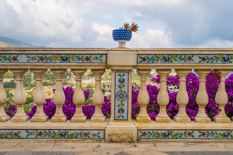 Carved handrail with ceramic pattern and surmounted by a blue ba. Sin with a cactus in the city Santo Stefano di Camastra in northern Sicily stock photo