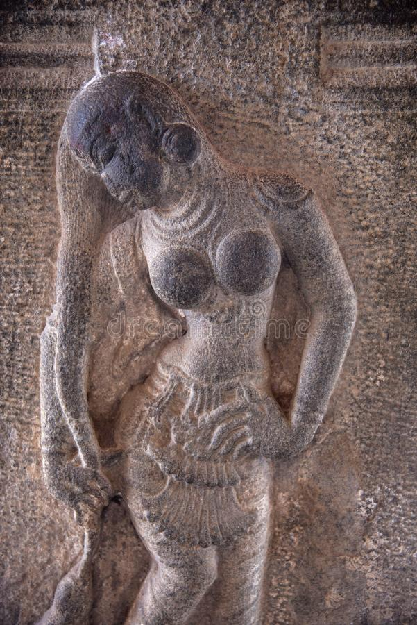 Carved idol on the outer wall of the Brihadishvara Temple an UNESCO World Heritage Site, Thanjavur, Tamil Nadu, India. Carved idol on the outer wall of the stock photography