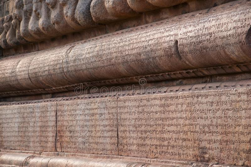 Carved inscriptions in Chola Grantha script and Tamil letters. Brihadishvara temple, Thanjavur, Tamil Nadu, India. Carved inscriptions in Chola Grantha script stock photography