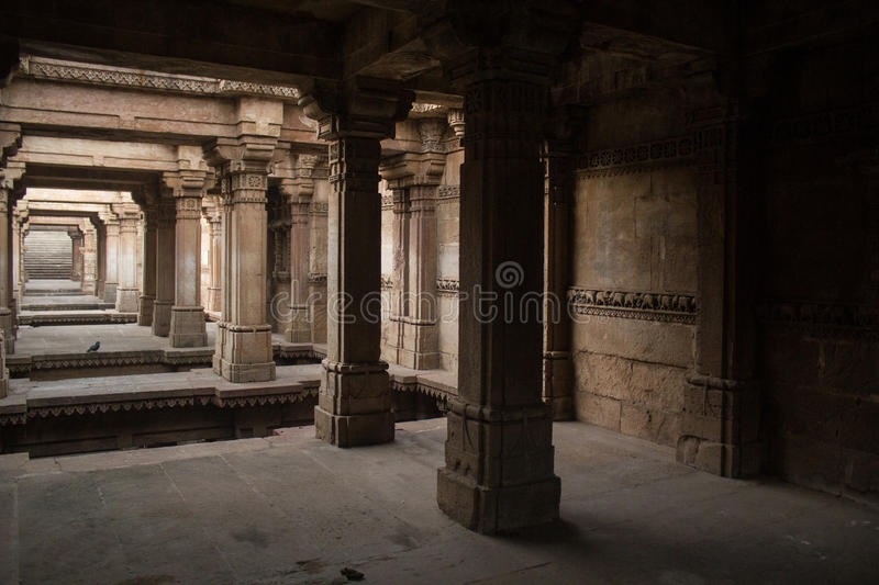 Carved pillars of Adalaj step well. royalty free stock image
