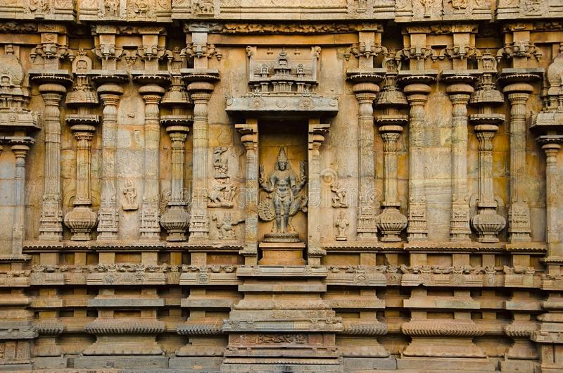 Carved pillars and idols on the outer wall of the Brihadishvara Temple, Thanjavur, Tamil Nadu, India. Carved idol on the inner wall of the Brihadishvara Temple stock photography