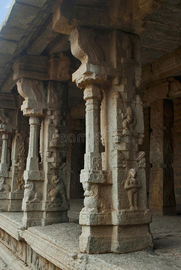 Carved pillars of the inner courtyard, cloisters or pillared verandah, Achyuta Raya temple, Hampi, Karnataka. Sacred Center. Carved pillars of the inner stock images