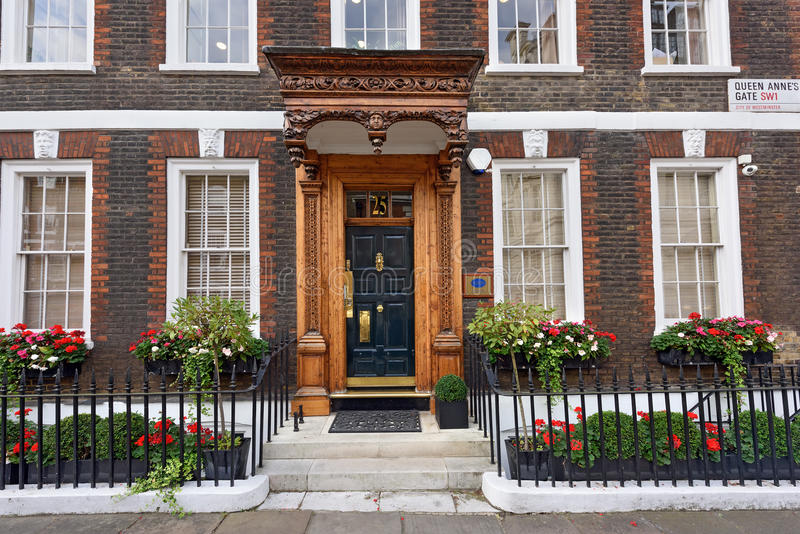 The carved porch of the Noon Group Building. Westminster, London, UK. The carved wooden porch of the Noon Group Building in Queen Anne's Gate. Westminster royalty free stock image
