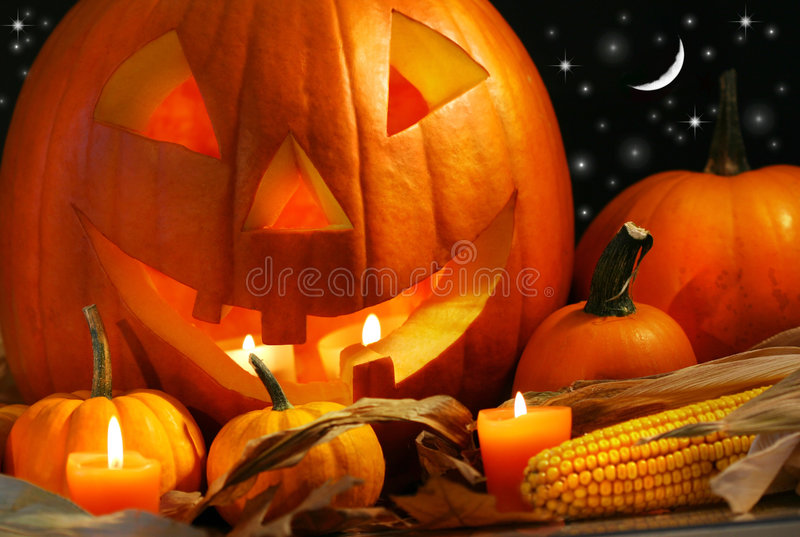 Carved Pumpkin With Candles Stock Image